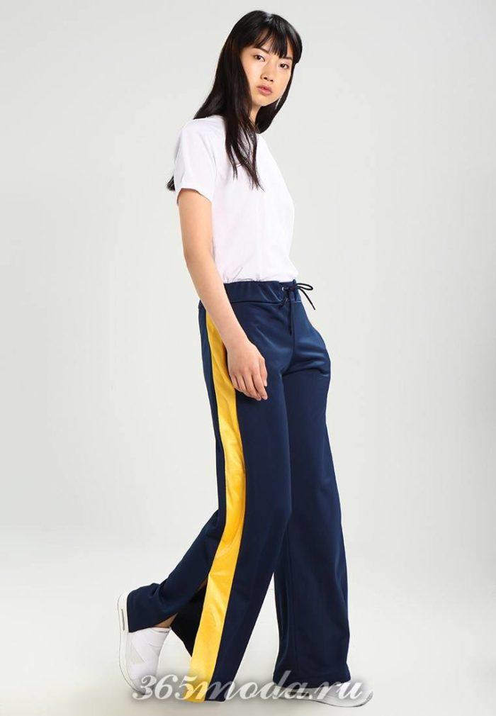 Расклешенные брюки синие