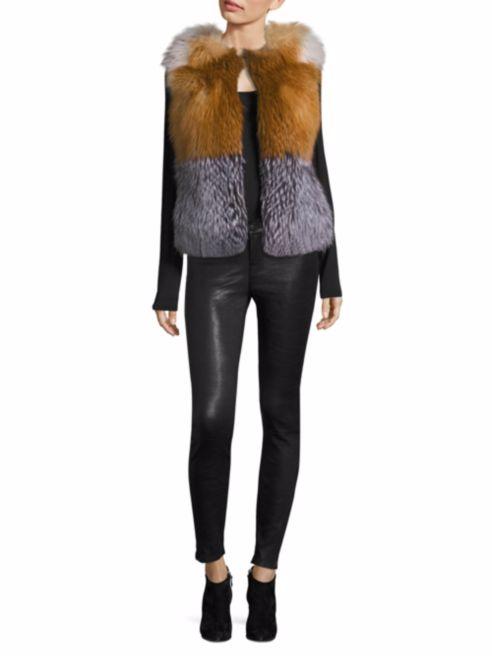двухцветный короткий меховой жилет с кожаными брюками