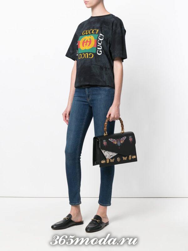 черная сумка с объемными рисунками