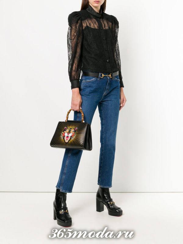 темная сумка с объемным рисунком