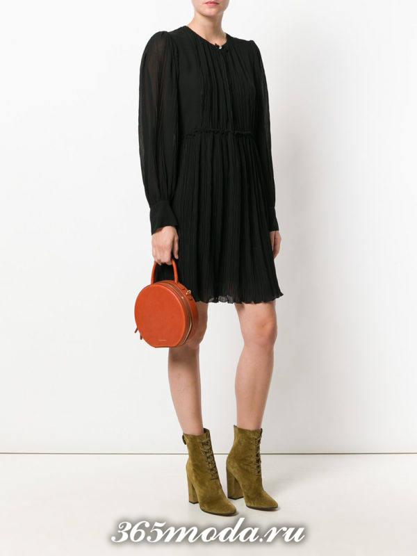 коричневая маленькая круглая сумка