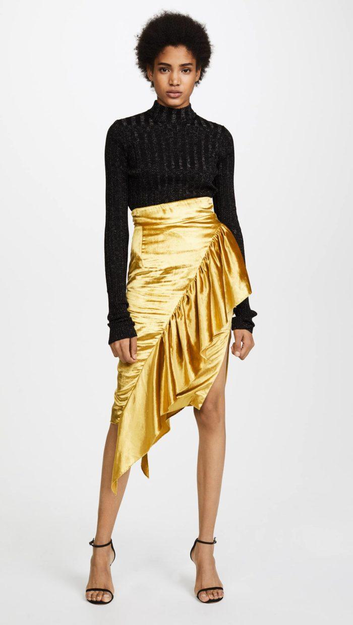 новогодний комплект из золотой юбки и черной блузы для знака зодиака рак