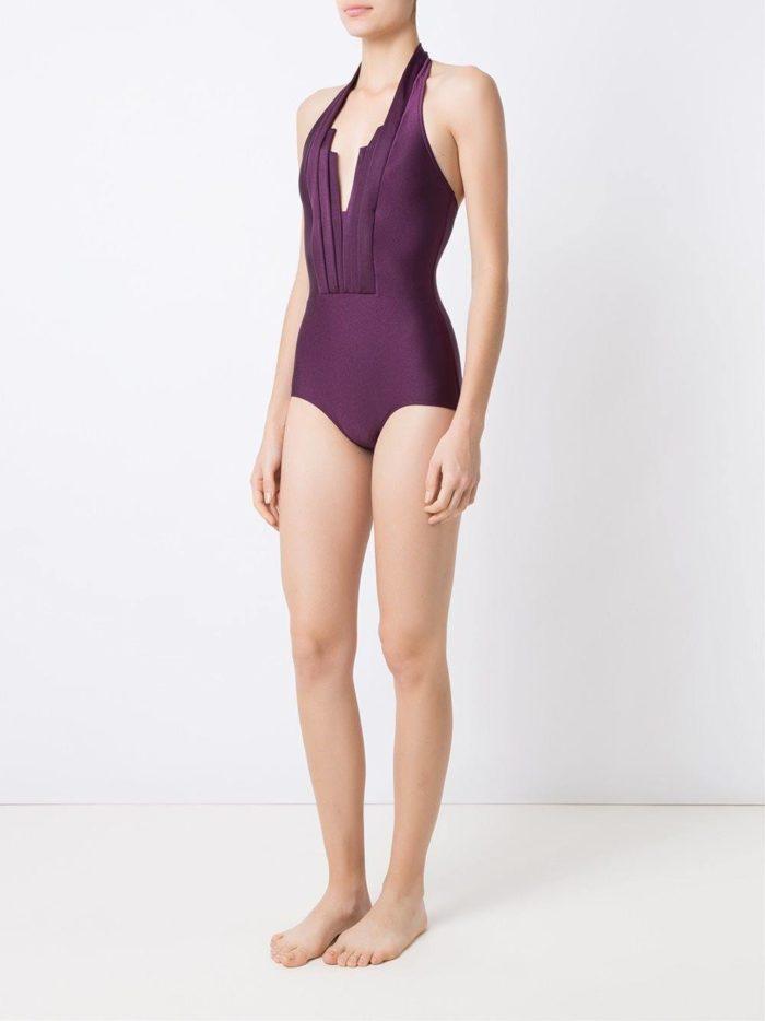 Пляжная мода 2019: сдельный фиолетовый купальник с вырезом